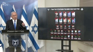 Prime Minister Benjamin Netanyahu displays Friday a list of Palestinian terrorists he says were eliminated by Israel during the Gaza fighting