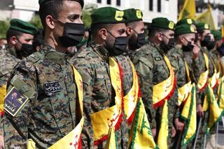 Hezbollah fighters attend a funeral procession of an operative killed in an airstrike attributed to Israel