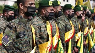Hezbollah fighters attend the funeral procession of their comrade Mohammed Tahhan who was shot dead on Friday by Israeli forces along the Lebanon-Israel border, in the southern village of Adloun, Lebanon