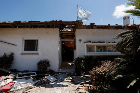 The home of Uri Kimchi with an Israeli flag after being destroyed by rocket fire from Gaza earlier this month