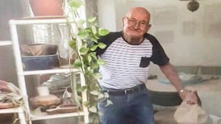 88-year old Uri Kimchi emerges from his bomb shelter after his house takes a direct hit from a rocket launched in Gaza