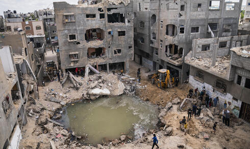 A crater remains where the al Masri home stood before it was destroyed in an Israeli strike onBeit Hanoun in the northern Gaza Strip