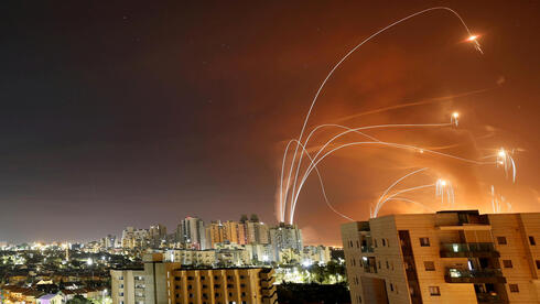 Streaks of light are seen as Israel's Iron Dome anti-missile system intercept rockets launched from the Gaza Strip towards Israel, as seen from Ashkelon,