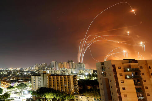 The light streaks are seen as the Israeli Iron Dome anti-missile system that intercepts rockets fired from the Gaza Strip towards Israel, as seen from Ashkelon,