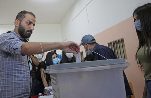 A Syrian man casts his vote during presidential elections in Damascus on Wednesday