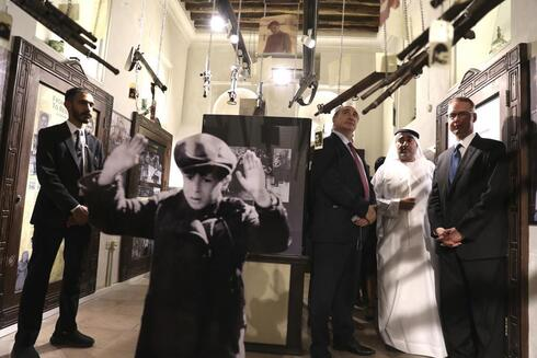 Israeli's Ambassador to the United Arab Emirates, Eitan Na'eh, third right, Ahmed Al Mansuri, founder of Crossroads of Civilization private museum, second right, and German Amabassador in UAE, Peter Fischer, right, visit an exhibition commemorating the Jewish Holocaust in Dubai