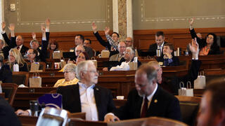 Republicans in the Kansas House raise their hands to force a roll-call vote on a resolution expressing solidarity with Israel and condemning Hamas militants following their recent war in the Gaza Strip, Wednesday, May 26, 2021