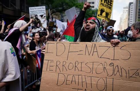 Pro-Palestinian supporters demonstrate near the Israeli Consulate following the flare-up of Israeli-Palestinian violence, in the Manhattan borough of New York City, New York, US, May 18, 2021.