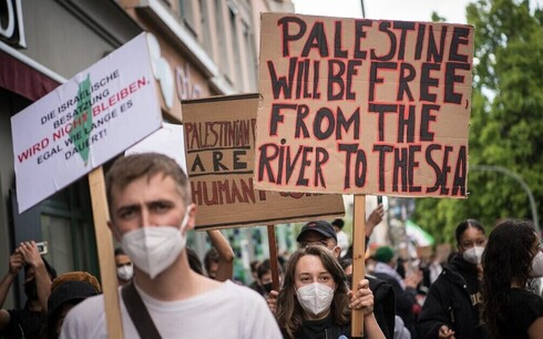 Pro-Palestinian protesters in Berlin take part in a demonstration against Israel amid the fighting in Gaza between the Israeli military and Hamas terror group, May 15, 2021.