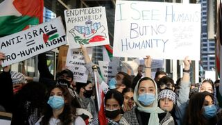 Hundreds of protesters gather and protest in support of Palestinians in front of the Consulate General of Israel on May 12, 2021 in Chicago.