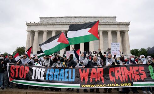Supporters of the Palestinians rally during the National March for Palestine demonstration at the Lincoln Memorial in Washington, May 29, 2021.