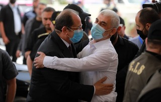 Egyptian intelligence chief Kamel Abbas, left, embraces Hamas leader Yahya Sinwar at a meeting in Gaza on Monday