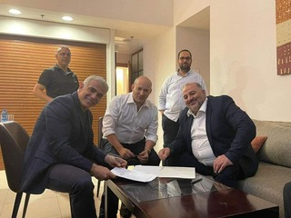 L-R: Yesh Atid head Yair Lapid, Yamina head Naftali Bennett and Ra'am chair Mansour Abbas signing a coalition agreement late Wednesday