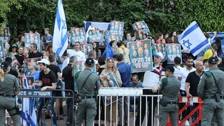 Right-wing demonstrators protest formation of Bennett-Lapid government outside Kfar Maccabiah Hotel in Ramat Gan where coalition talks were held