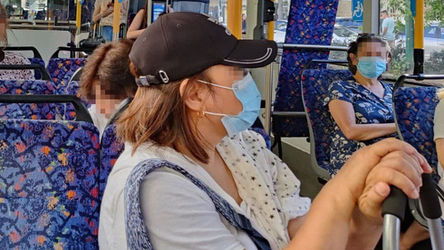 Passengers wearing masks on a bus even after the mask mandate was lifted