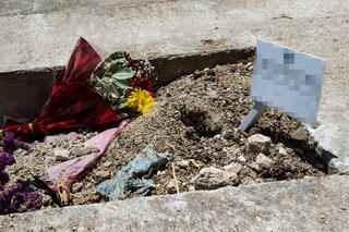 The burial plot of the intelligence officer who died in military prison