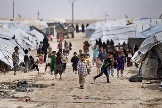 Children gather outside their tents, at al-Hol camp, which houses families of members of the Islamic State group, in Hasakeh province, Syria, Saturday, May 1, 2021