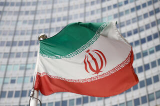 The Iranian flag waves in front of the International Atomic Energy Agency (IAEA) headquarters, before the beginning of a board of governors meeting in Vienna, Austria