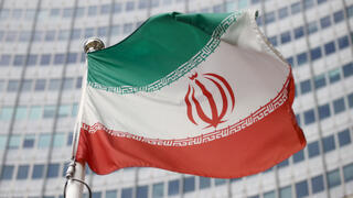 The Iranian flag waves in front of the International Atomic Energy Agency (IAEA) headquarters, before the beginning of a board of governors meeting, amid the coronavirus disease (COVID-19) outbreak in Vienna, Austria