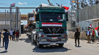 Egyptian material, workers and equipment entering Gaza through the Rafah border crossing