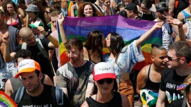 Revelers celebrate along a seaside avenue in Tel Aviv during the city's annual Pride Parade on June 8, 2018