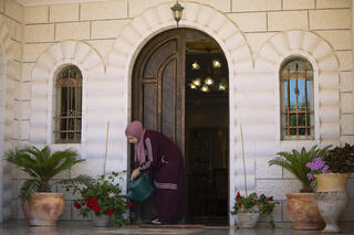 Sanaa Shalaby, the estranged wife of Muntasser Shalaby, outside her home on the West Bank