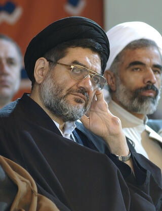 Ali Akbar Mohtashamipour listens to a speaker in a meeting in Tehran, Iran, on Dec. 4, 2003