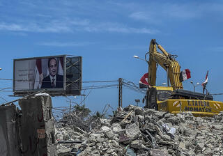 A poster of Egyptian President Abdel Fattah al-Sisi stands over the rubble of a building in Gaza hit by the IDF during the fighting last month