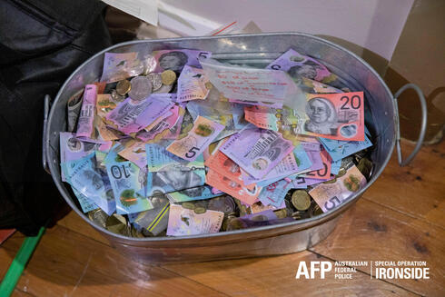 Money seized by Australian Federal Police are seen after its Operation Ironside against organized crime