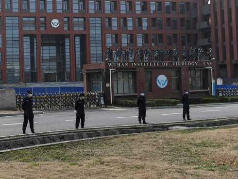 Chinese security men outside the Wuhan Institute of Virology
