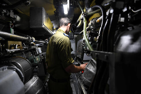 The chief machinist of Israeli navy submarine Leviathan takes a Reuters correspondent on a tour of the engine room during a sailing in the Mediterranean Sea off the coast of Haifa, northern Israel