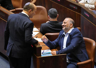 Prime Minister Naftali Bennett and Ra'am leader Mansour Abbas in the Knesset, June 2021