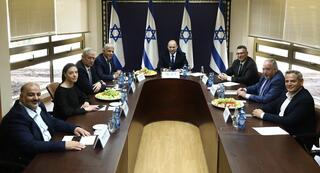 The heads of the parties in the new coalition meet at the Knesset before the government was set to be sworn in on Sunday