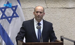 Prime Minister-designate Naftali Bennett addresses Knesset on Sunday before a vote to confirm his new government