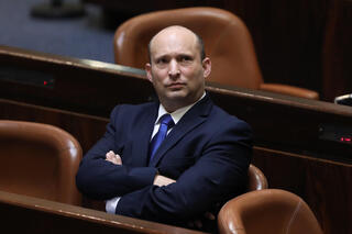 Naftali Bennett watches the Knesset vote that made him prime minister on Sunday night