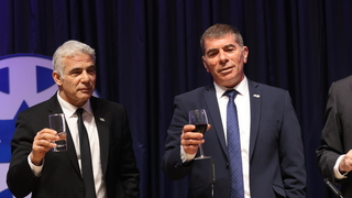 Foreign Minister Yair Lapid and outgoing Foreign Minister Gabi Ashkenazi at transfer of power ceremony in Jerusalem on Monday