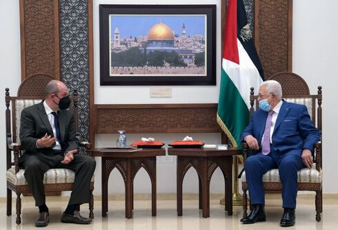 President Mahmud Abbas (R) meeting with the US envoy for Israel-Palestinian affairs Hady Amr