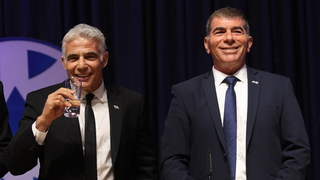 Foreign Minister Yair Lapid, left, attending a handover ceremony with his predecessor Gabi Ashkenazi in Jerusalem on Monday