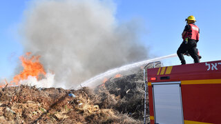 Firefighters battling flames caused by incendiary balloons
