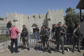 Police at the Damascus Gate entrance to the Old City of Jerusalem ahead of the flag parade Tuesday