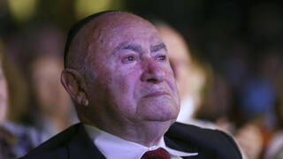 David Einhorn, 95, sheds a tear as at an event held to honor Holocaust survivors in NY on Monday