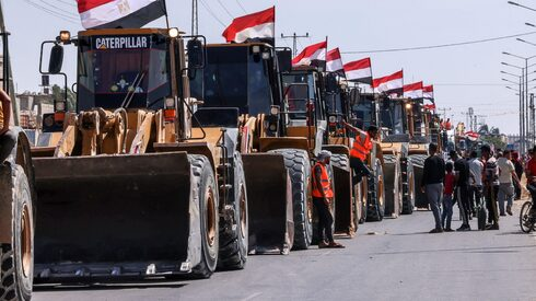 A convoy of Egyptian bulldozers arrives on the Gaza side of the Rafah border crossing between Egypt and the Strip, June 4, 2021