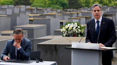 U.S. Secretary of State Blinken speaks next to German Foreign Minister Heiko Maas during a visit at Holocaust Memorial as a part of Holocaust Dialogue signing event in Berlin