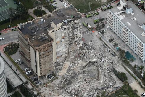 aerial photo shows part of the 12-story oceanfront Champlain Towers South Condo that collapsed early Thursday, June 24, 2021 in Surfside, Fla
