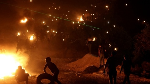 The protesting Palestinians burn tyres and the prevailing wind takes the acrid smoke towards the newly established Eviatar settlement