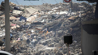 A Florida condominium tower collapse in Florida where more than 150 people are still missing and five bodies were found