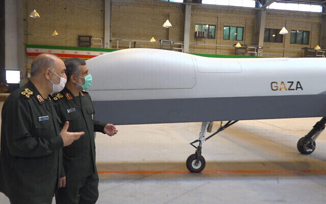 """Iranian Revolutionary Guard Commander Gen. Hossein Salami, left, and the Guard's aerospace division commander Gen. Amir Ali Hajizadeh talk while unveiling a new drone called """"Gaza"""" in an undisclosed location in Iran"""