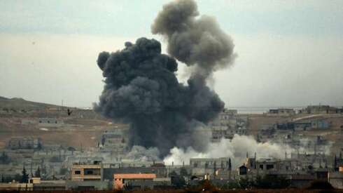 hick smoke rises following an airstrike by the US-led coalition in Kobani (Syria