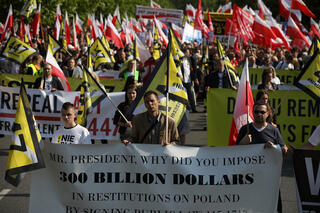 Poles hold a May 2019 protest in Warsaw over a U.S. law allowing Jews to claim compensation for property lost in Poland during the Holocaust