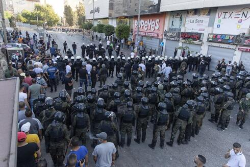 alestinian riot police and security officers in plainclothes clash with demonstrators following a rally protesting the death of Palestinian Authority outspoken critic Nizar Banat